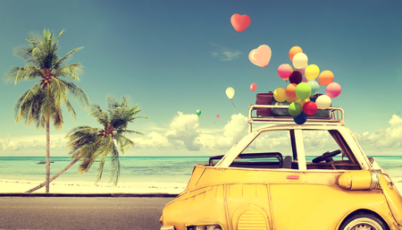 50569433 - vintage yellow car with heart colorful balloon on beach blue sky - concept of love in summer and wedding. honeymoon trip